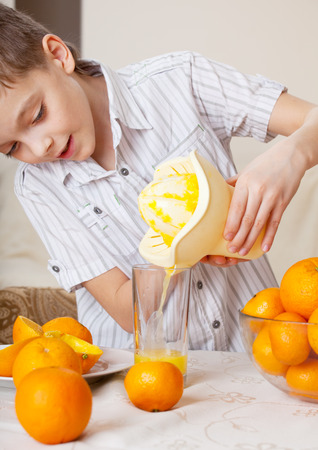 two persons only: Child with oranges. Boy squeezed orange juice.