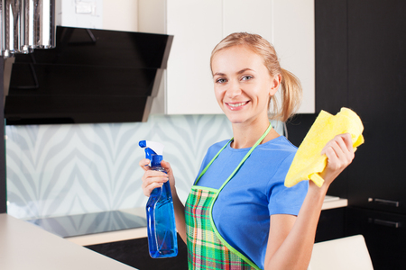 cleaning kitchen: Woman cleaning kitchen. Young woman washing house