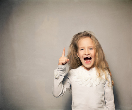 7 8 years: Child about school board. Girl near blackboard Stock Photo