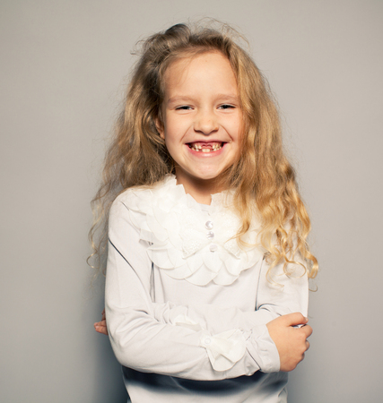 6 7 year old: Fun little girl with no teeth. Smiling child