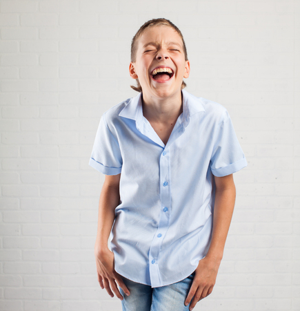 14 15 years: Happy boy. Smiling teenager at school Stock Photo