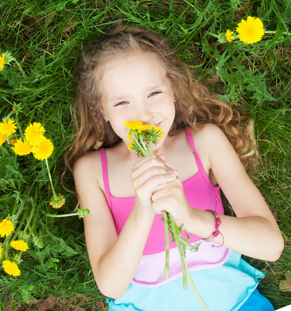 6 7 years: Child at summer. Happy girl outdoors on green grass Stock Photo