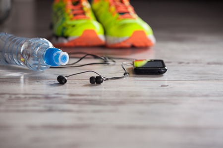 white clothes: Accessories for sports, lying on the floor in a fitness club Stock Photo