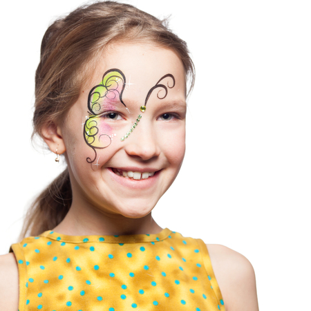 painting face: Girl with face painting. Child with body art Stock Photo