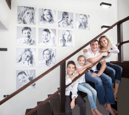 Family photos on the wall. Portraits of family stairwell Banque d'images