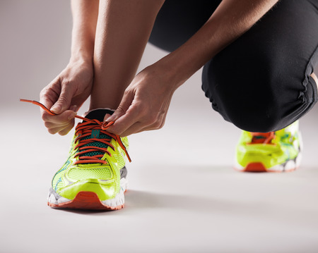 woman only: Sports. Girl tying shoelaces. Fitness