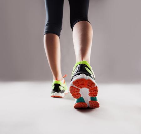indoors: Sports. Running girl indoors. Fitness Stock Photo