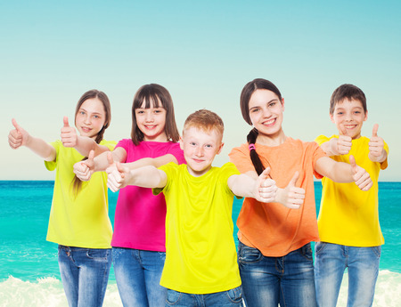frendship: Happy group children at sea. Smiling teen. Frendship boys and girls