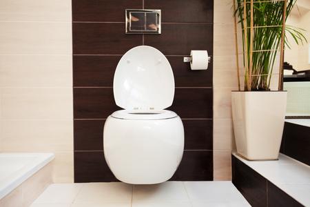modern bathroom: Hanging toilet in bathroom. Installation