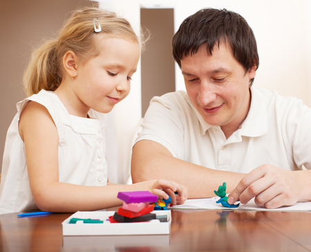 molded: Family molded from clay toys. Father play with girl