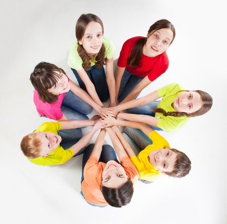frendship: Happy group children isolated at white background. unity teen. Frendship boys and girls