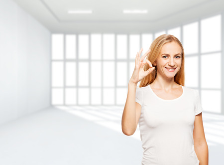 empty room: Happy businesswoman in empty office. Young smiling female inside Stock Photo
