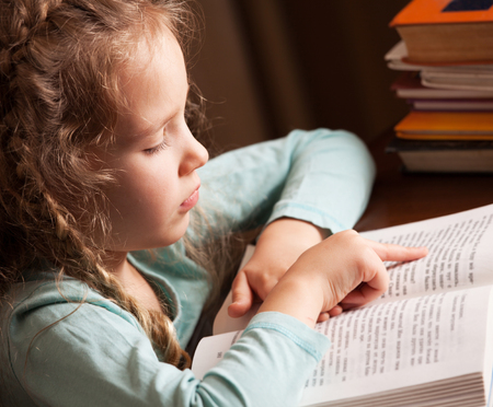 child learning: Girl reading book. Child education Stock Photo
