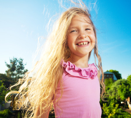 child laughing: Happy smiling child at summer. Laughing girl Stock Photo