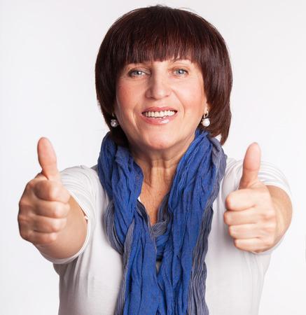 mature woman: Smiling mature woman. Happy female. Studio shot