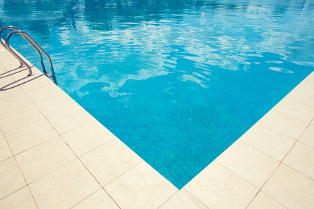 Empty pool outdoors. Summer vacations