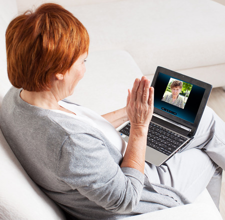 skype: Woman talking to her mother on the computer. Mature woman with  laptop. Female with computer at home Stock Photo