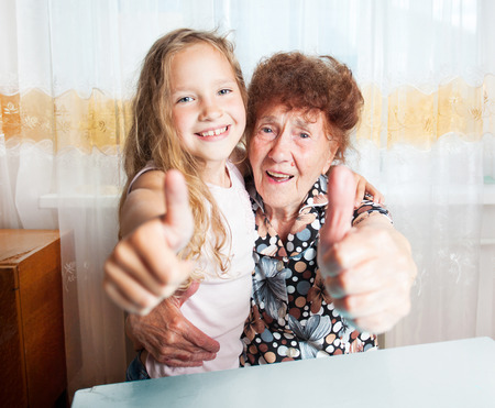 80 plus years: Senior with girl. Generation. Elderly woman with great-grandchild showing sign ok