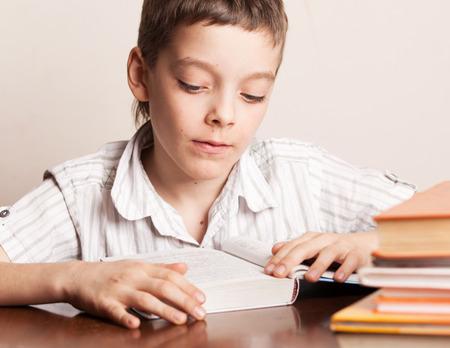 Boy reading book. Child education Stock Photo