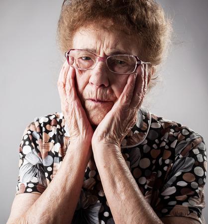 80 plus adult: Portrait  old woman. Sad adult female. Grandmother