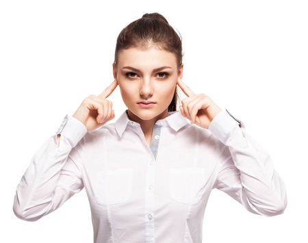 ignorance: Woman at white background. Young female covering her ears. Ignorance