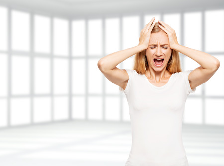 hysterics: Sad woman in the empty office. Fired unemployed person. Bankruptcy Stock Photo