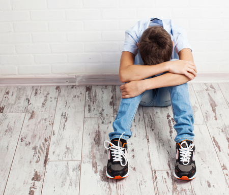 Sad teenager. Problems at school. Grief boy Standard-Bild