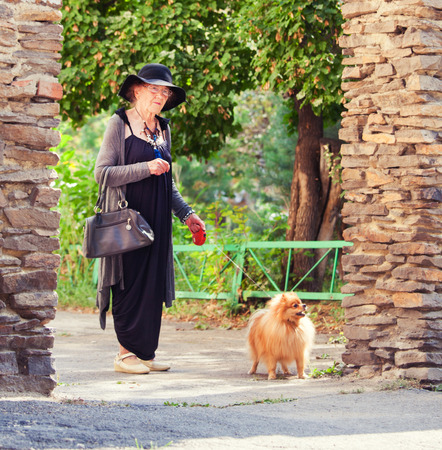 Stylish 90 years old woman walking around city. Granny female outdoors Stock Photo