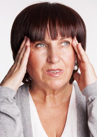Mature woman has a headache.