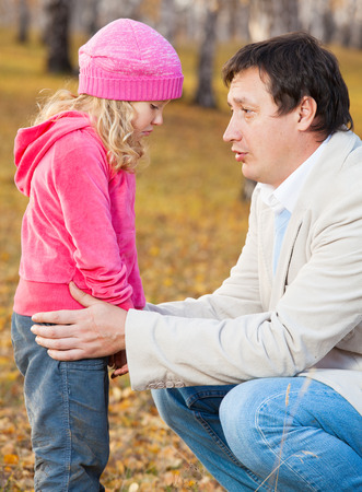 Dad pitying daughter. Sad child with father Stock Photo