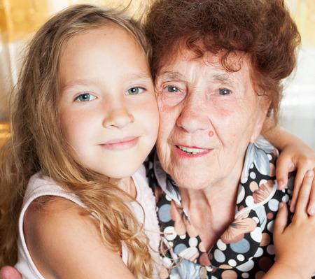 Senior with girl. Generation. Elderly woman with great-grandchild Stock Photo