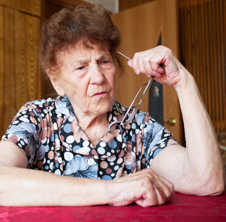 Old woman. Thinking elderly female at home Stock Photo