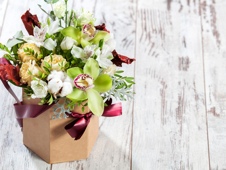 Bouquet flowers on wooden floor Stock Photo