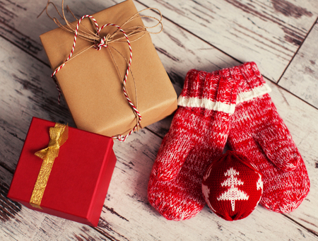 Gift with christmas ball on wood floor. Winter decoration Stock Photo