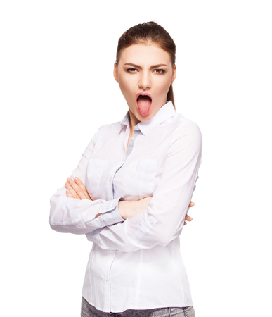 spunky: Woman showing tongue. disgust. Female isolated on white