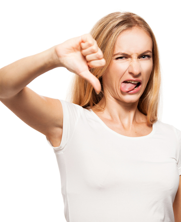 Woman showing thumbs down. Disgust