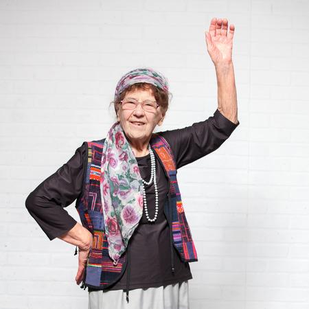 Elderly woman. Studio shot. Happy old female Stock Photo
