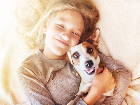 Smiling child with dog. Portrait girl with pet photo