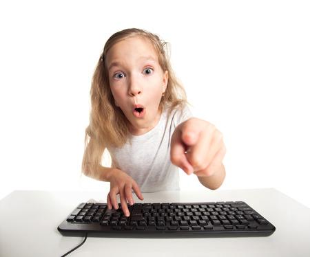 Child looking at a computer. Computer addiction photo