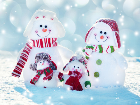 Family snowmans on snow. Friends at winter