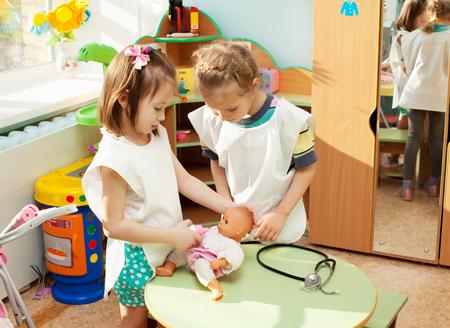 Child in kindergarten. Kids in nursery school. Girl playing at infant school