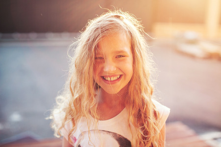 Happy child outdoors. Portrait one girl. Smiling child
