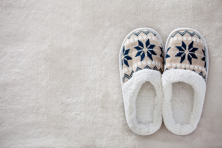 Slippers on the carpet. Soft comfortable home slipper Reklamní fotografie