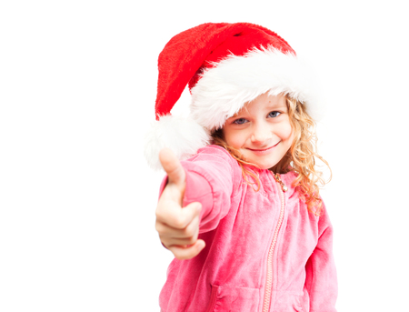 Girl in santa hat. Child isolated on white