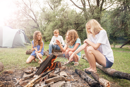 Teen in the camp by the fire