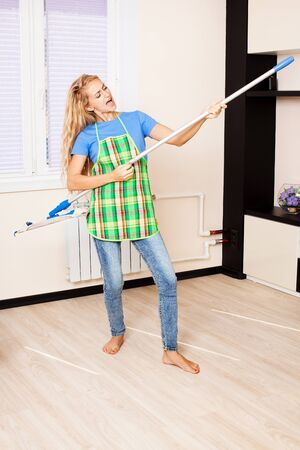 Funny woman with mop. Female cleaning home Stock Photo