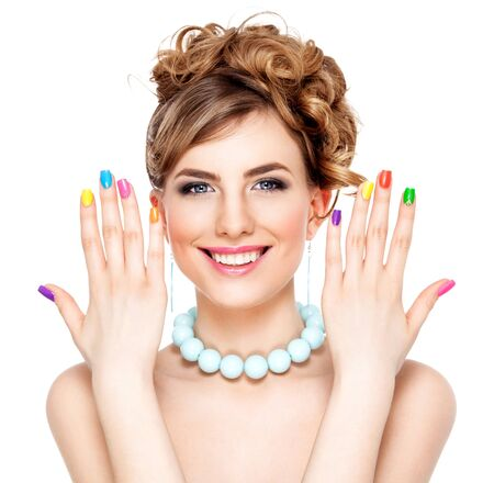 Young woman portrait with colorful makeup and nail polish, manicure, studio shot