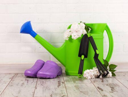 Garden accessories. Watering can, shovel rake for gardening Stock fotó
