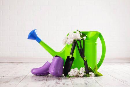 Garden accessories. Watering can, shovel rake for gardening