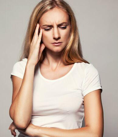 Upset woman. Sad female Headache Problems